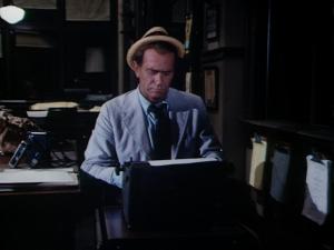 at typewriter