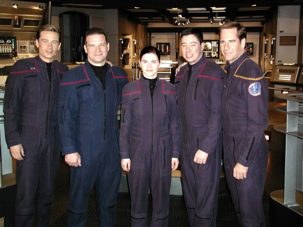 USS Enterprise (CVN 65) Feb. 28, 2002 -- Sailors of the Year for the year 2001 meet castmembers of the latest Star Trek television series entitled Enterprise. Pictured here on the set of the series are (from left) Conner Trinneer, who plays Chief Engineer Charles Trip Tucker, III; Aviation Electronics Technician 1st Class Robert S. Pickering, Sailor of the Year; Personnelman 3rd Class Sarah E. Pizzo, Blue Jacket of the Year; Aviation Electricians Mate 2nd Class Timothy J. Whittington, Junior Sailor of the Year; and Scott Bakula, who plays Capt. Jonathan Archer. The three Sailors were given the opportunity to appear in a scene during an episode which aired recently.